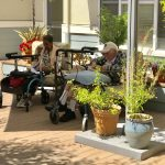 This is life. Relaxing under the beautiful sun on the patio. Residents Walterlene and Arthur are doing just that!