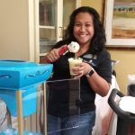 Community Life Director, Janice Gombio. Service with a smile!