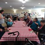 Residents waiting patiently for Jessica to open their bags of corn chips.  One of the favorites in the picnic basket!